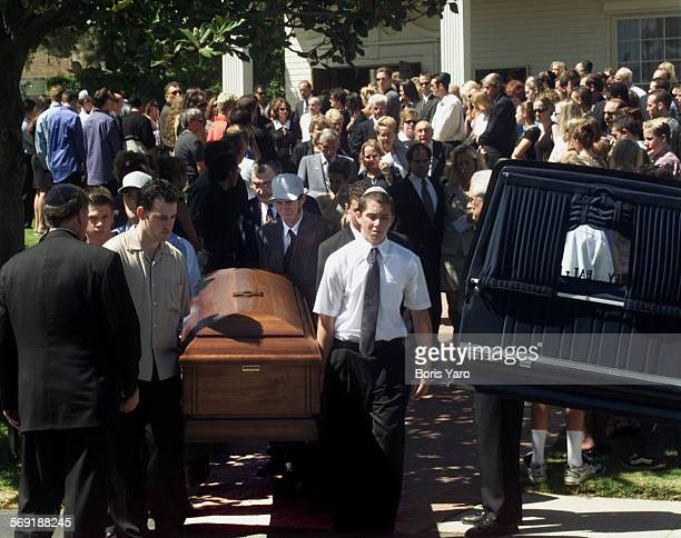 Pall bearers bring casket of Nicholas Samuel Markowitz out of chapel at Groman Eden Mortuary in Mission Hills