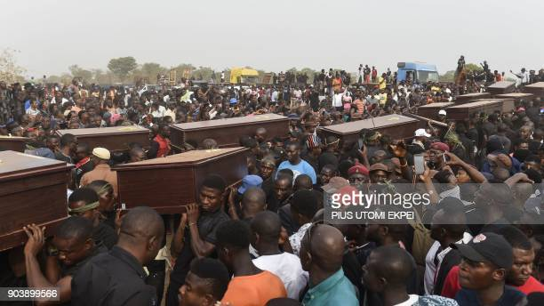 TOPSHOT Pall bearers carry coffins during the funeral service for people killed during clashes between cattle herders and farmers on January 11 in...