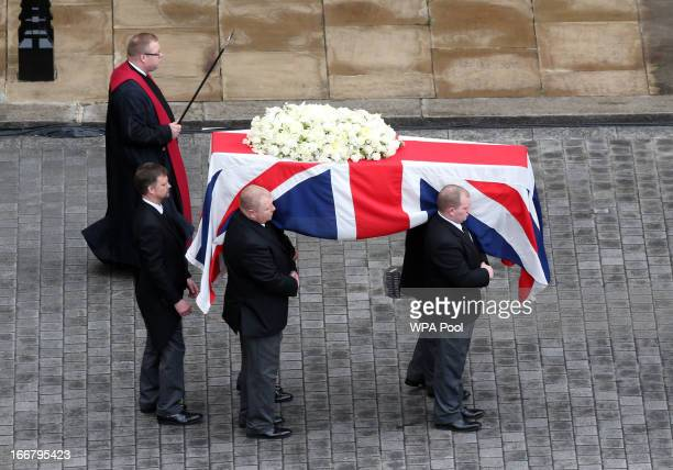 Pall bearers carry the coffin containing the body of Baroness Magaret Thatcher from the Palace of Westminster where it rested overnight in the chapel...