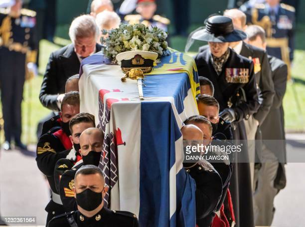 Pall Bearers carry the coffin of Britain's Prince Philip, Duke of Edinburgh, followed by members of the Royal family inside St George's Chapel in...