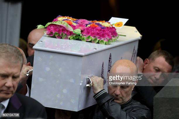 Pall bearers carry the coffin of Manchester attack victim Lisa Lees after her funeral service at St Anne's Church on June 23 2017 in Oldham England...