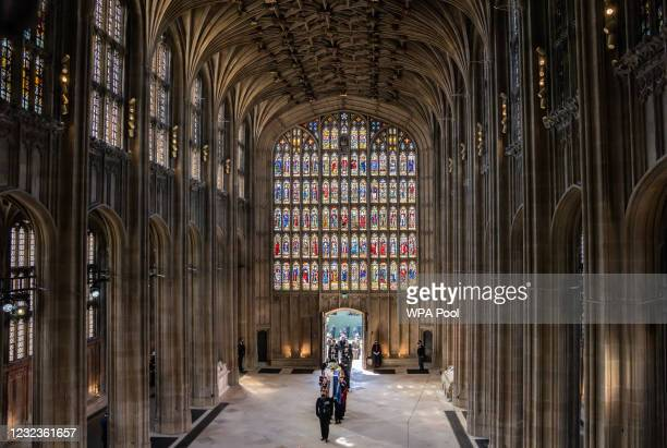 Pall Bearers carry the coffin of the Prince Philip, Duke of Edinburgh, followed by members of the Royal family into St George's Chapel at Windsor...