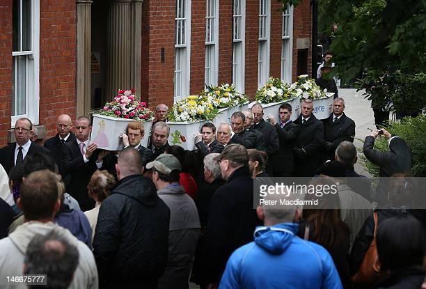 Pall bearers carry the coffins of the six Philpott children from St Mary's Church after a funeral service on June 22 2012 in Derby England Hundreds...