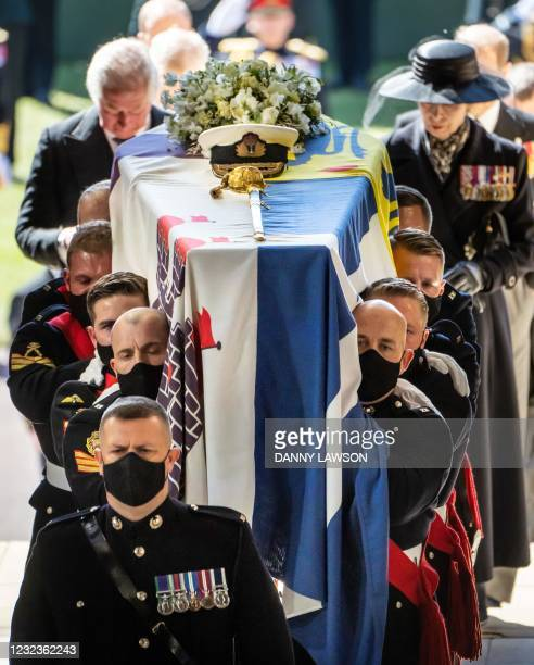 Pall Bearers carrying the coffin for the funeral service of Britain's Prince Philip, Duke of Edinburgh inside St George's Chapel in Windsor Castle in...