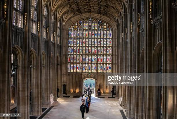 Pall Bearers carrying the coffin of the Britain's Prince Philip, Duke of Edinburgh and followed by members of the Royal family enter St George's...