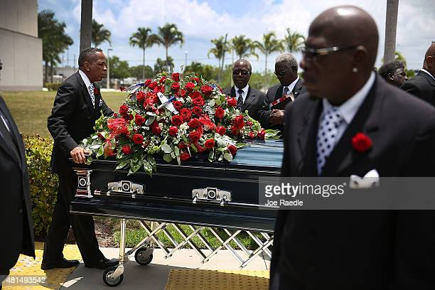 Pall bearers from Paradise Memorial Funeral Home take the casekt of retired Air Force Lt Col Eldridge Williams to the hearse after a funeral service...