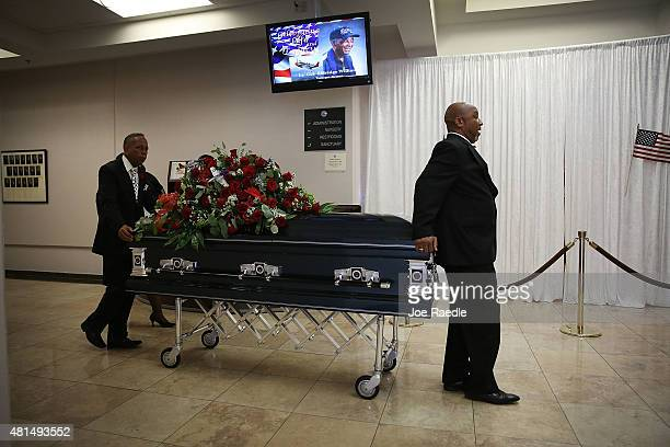 Pall bearers from Paradise Memorial Funeral Home take the casket of retired Air Force Lt Col Eldridge Williams to the hearse after a funeral service...