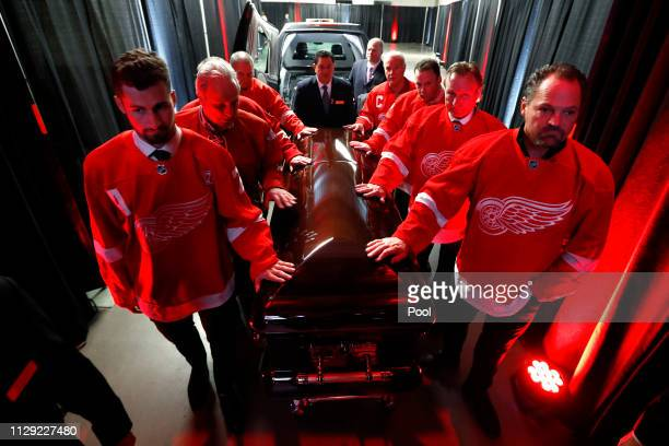 Pall Bearers including Dylan Larkin left and Joe Kocur move the casket of former Detroit Red Wings player Ted Lindsay at a public viewing Friday...