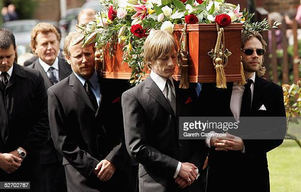 Pall bearers including grandson Crispian Mills carry the coffin of Sir John Mills into The Parish Curch of Saint Mary the Virgin on April 27 2005 in...