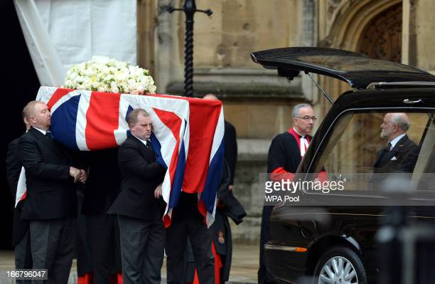 Pall bearers load the coffin containing the body of Baroness Magaret Thatcher into a hearse as it is taken from the Palace of Westminster where it...