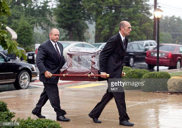 Pall bearers walk the remains of Lauren Giddings into her funeral service at St Mary of the Mills Catholic Church in Laurel Maryland Saturday August...