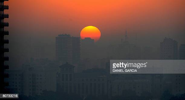 A pall of smoke covers Palermo neighborhood at dusk on April 17 2008 as massive brush fires set by cattle ranchers and soybean farmers in the Parana...