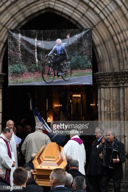 Pallbearer carry the coffin of French cyclist Raymond Poulidor during his funeral in SaintLeonarddeNoblat on November 19 2019 French cyclist Raymond...