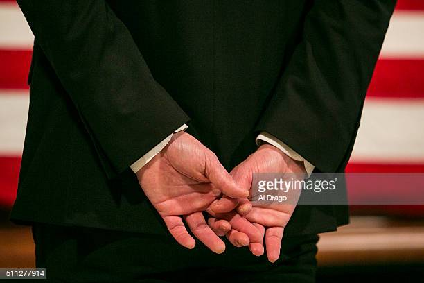 STATES FEB 19 A pallbearer holds his hands as he stands watch as members of the public pass through the Great Hall of the Supreme Court as they pay...