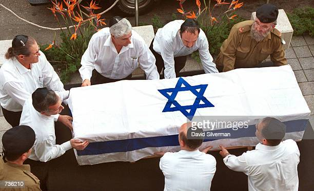 Pallbearers and an Israeli army rabbi lay down the flag-draped coffin of Leah Rabin, wife of assassinated former Prime Minister Yitzhak Rabin, at the...