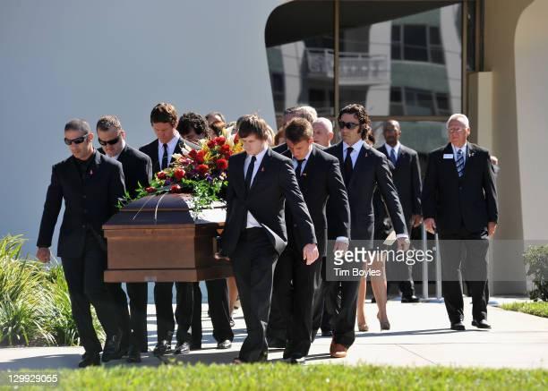 Pallbearers Austen Wheldon Elliott Wheldon Ashley Wheldon Dario Franchitti Scott Dixon and Tony Kanaan carry Dan Wheldon's casket to the hearse...