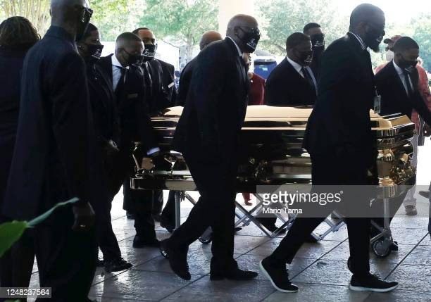 Pallbearers bring the casket bearing the remains of George Floyd into the Fountain of Praise church for his memorial and funeral services on June 8...