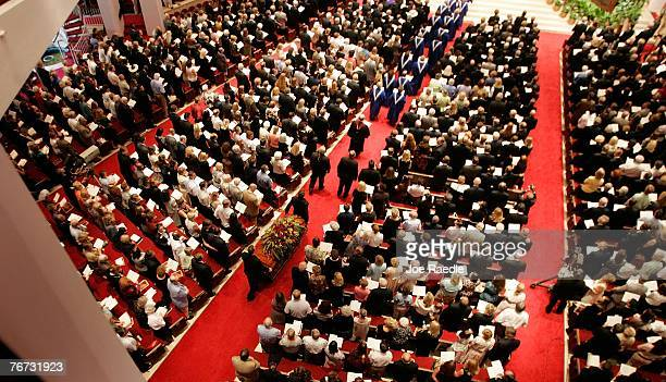 Pallbearers bring the casket of televangelist Dr D James Kennedy into the Coral Ridge Presbyterian Church September 13 2007 in Fort Lauderdale...