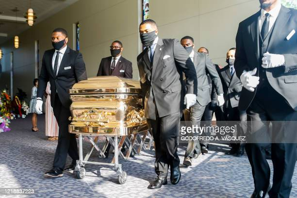 TOPSHOT Pallbearers bring the coffin into the church for the funeral for George Floyd on June 9 at The Fountain of Praise church in Houston Texas...