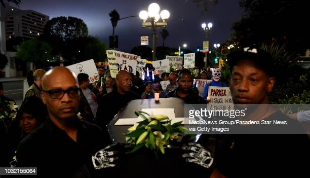 Pallbearers carry a casket during a housing and homeless advocates funeral procession and Candlelight March to mourn the destruction of the former LA...