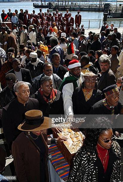 Pallbearers carry a coffin containing containing the remains of free and enslaved AfricanAmericans 03 October after it arrived at Pier 11 a...