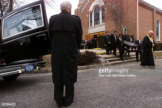 Pallbearers carry casket from St George Greek Orthodox Church during funeral for Costas 'Gus' Christofi limousine driver who was shot at the home of...