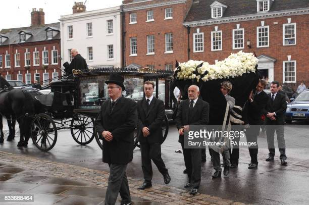 Pallbearers carry Isabella Blow's coffin into Gloucester Cathedral for her funeral service