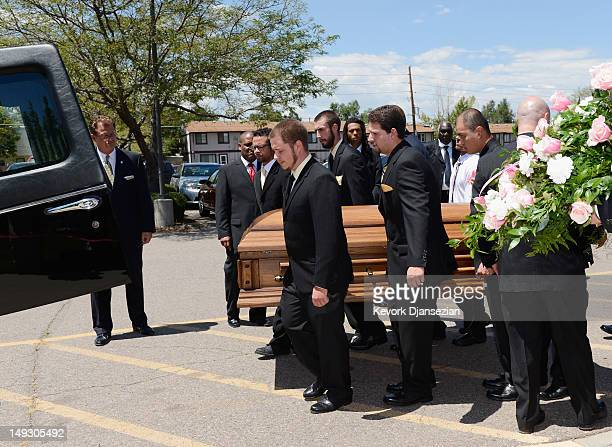 Pallbearers carry Micayla Medek during her funeral at the New Hope Baptist Church July 26 2012 in Denver Colorado Twentyfouryearold James Holmes is...