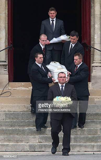 Pallbearers carry on April 6 during a funeral ceremony at the Saint Eloi church in SaintQuentin northern France the coffin of one of the five...
