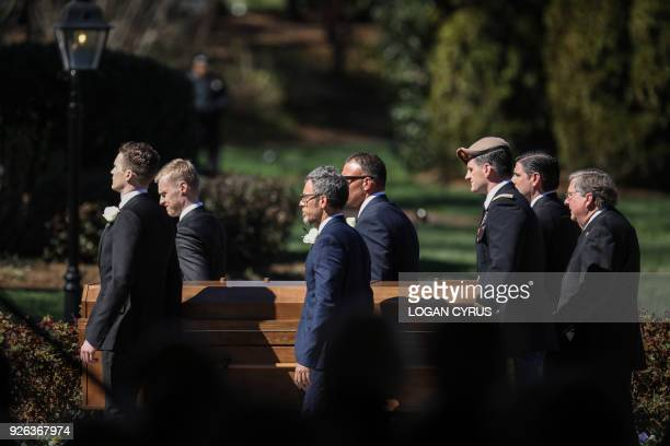 Pallbearers carry the body during the funeral of Reverend Billy Graham in Charlotte North Carolina Graham who preached to millions of faithful face...