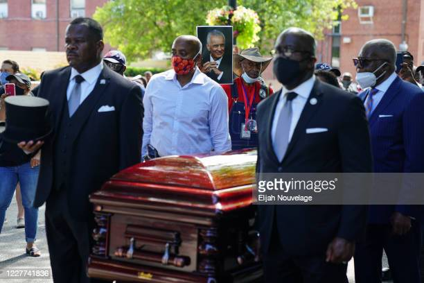 Pallbearers carry the body of civil rights leader C.T. Vivian past Martin Luther King Jr. National Historic Park on July 22, 2020 in Atlanta,...