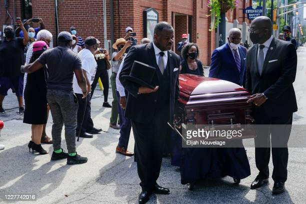Pallbearers carry the body of civil rights leader C.T. Vivian past Ebenezer Baptist Church on July 22, 2020 in Atlanta, Georgia. Rev. Cordy Tindell...