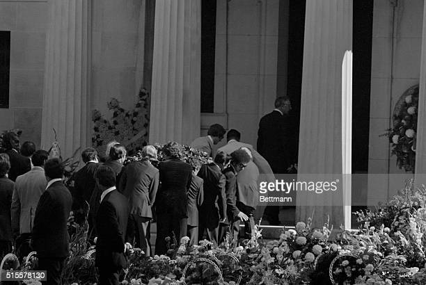 Pallbearers carry the casket containing Elvis Presley's body into the mausoleum in Memphis Tennessee