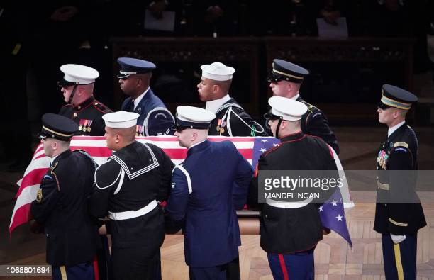Pallbearers carry the casket containing former US president George H W Bush following a funeral service at the National Cathedral in Washington DC on...