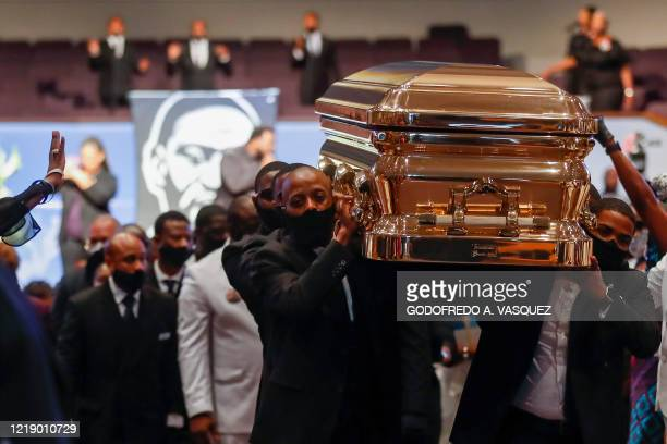TOPSHOT Pallbearers carry the casket following the funeral of George Floyd June 9 at The Fountain of Praise church in Houston George Floyd will be...
