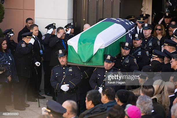 Pallbearers carry the casket for the funeral of slain New York Police Department officer Rafael Ramos at the Christ Tabernacle Church on December 27...