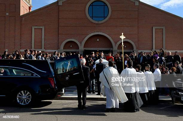 Pallbearers carry the casket from Holy Trinity Catholic Church following a funeral for Jessica Hernandez in Westminster CO on February 7 2015 Over...