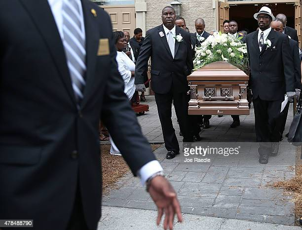 Pallbearers carry the casket of Ethel Lance who was one of nine victims of a mass shooting at the Emanuel African Methodist Episcopal Church out of...