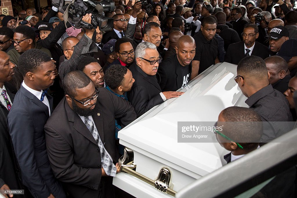 Pallbearers carry the casket of Freddie Gray to the hearse after his funeral service at New Shiloh Baptist April 27, 2015 in Baltimore, Maryland. Gray, 25, was arrested for possessing a switch blade knife April 12 outside the Gilmor Homes housing project on Baltimore's west side. According to his attorney, Gray died a week later in the hospital from a severe spinal cord injury he received while in police custody.