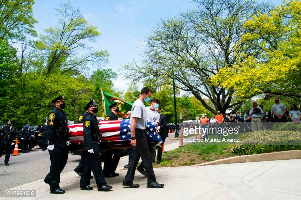 Pallbearers carry the casket of Glen Ridge Police Officer Charles Roberts during his funeral after he passed away from the coronavirus on May 14 2020...