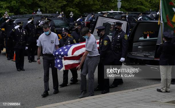 Pallbearers carry the casket of Glen Ridge Police Officer Charles Rob Roberts who died of coronavirus weeks after contracting the disease while on...