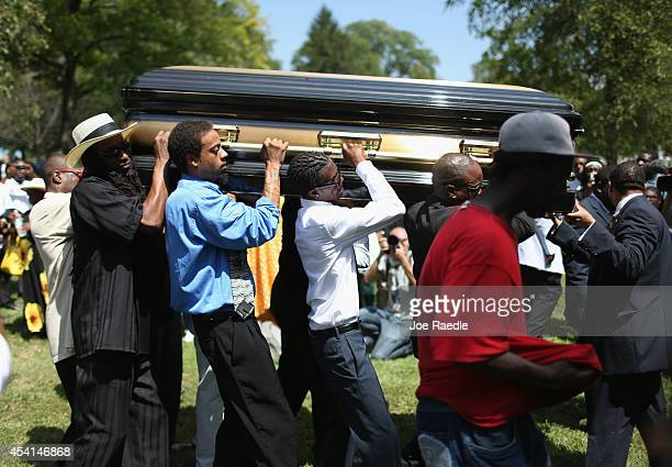 Pallbearers carry the casket of Michael Brown at St Peter's cemetery during the funeral service on August 25 2014 in St Louis Missouri Michael Brown...