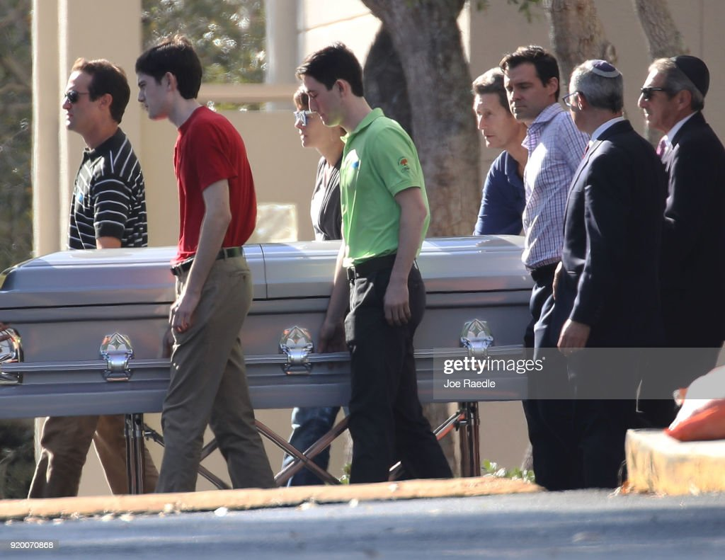 Pallbearers carry the casket of Scott Beigel, geography teacher from Marjory Stoneman Douglas High School, after a funeral service at Temple Beth-El on February 18, 2018 in Boca Raton, Florida. Beigel was one of 17 people killed in the February 14 school shooting in Parkland, Florida. Police arrested and charged 19 year old former student Nikolas Cruz for the 17 murders.