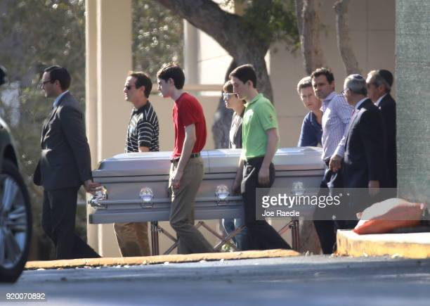 Pallbearers carry the casket of Scott Beigel geography teacher from Marjory Stoneman Douglas High School after a funeral service at Temple BethEl on...