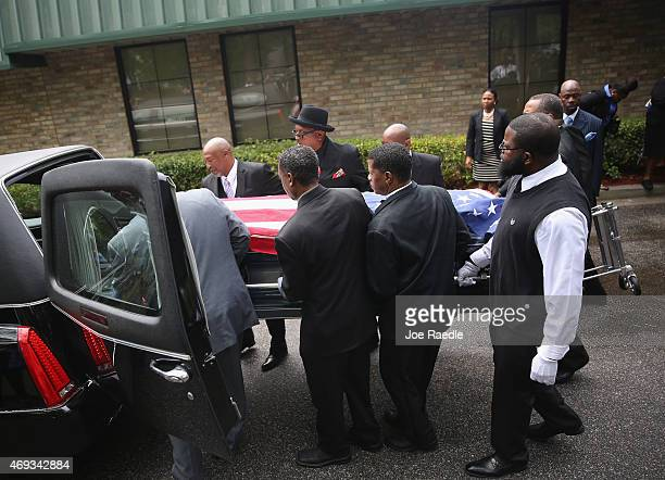Pallbearers carry the casket of Walter Scott to the hearse after a funeral service at the WORD Ministries Christian Center after he was fatally shot...