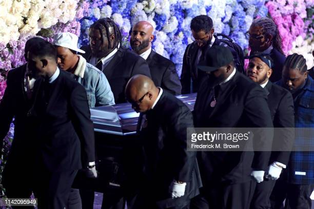 Pallbearers carry the casket off stage during Nipsey Hussle's Celebration of Life at STAPLES Center on April 11 2019 in Los Angeles California Nipsey...