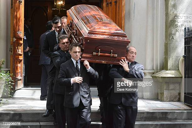 Pallbearers carry the coffin at the funeral for former Bachelor contestant Gia Allemand at Trinity Grace Church on August 22 2013 in New York New...