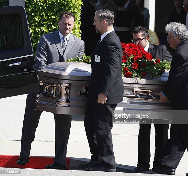 Pallbearers carry the coffin during Cyd Charisse's Funeral Service at Hillside Memorial Park on June 22 2008 in Culver City California