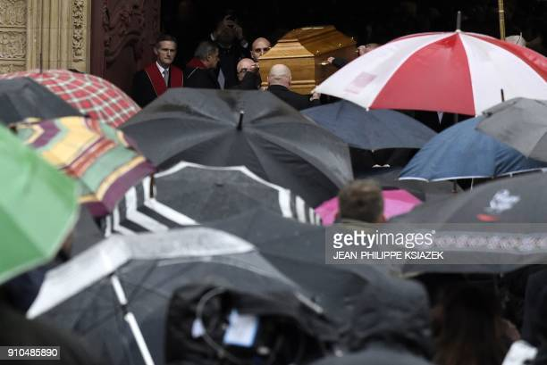 Pallbearers carry the coffin French chef Paul Bocuse at the end of the funeral ceremony held at the SaintJean Cathedral in Lyon on January 26 2018...