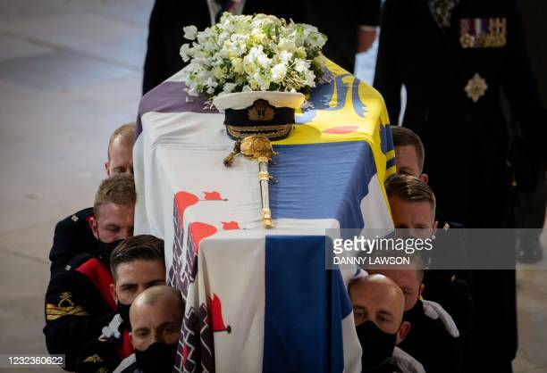 Pallbearers carry the coffin in St George's Chapel during the funeral of Britain's Prince Philip, Duke of Edinburgh in Windsor Castle in Windsor,...